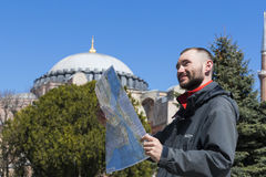 Tourists looking at the map in Istanbul amidst the sights Royalty Free Stock Photos