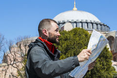 Tourists looking at the map in Istanbul amidst the sights Stock Photos