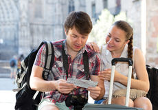 Tourists looking at the map Royalty Free Stock Photo