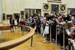 Tourists looking at Mona  Lisa Royalty Free Stock Photo