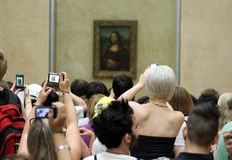 Tourists Looking at Mona Lisa stock photography