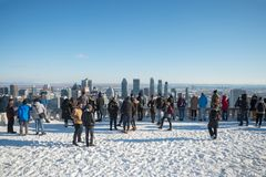 Tourists looking at Montreal Skyline from the Kondiaronk Belvedere royalty free stock images