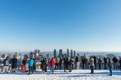 Tourists looking at Montreal Skyline royalty free stock image