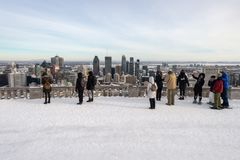 Tourists looking at Montreal Skyline from ondiaronk belvedere stock photo