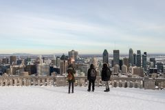 Tourists looking at Montreal Skyline from ondiaronk belvedere royalty free stock image