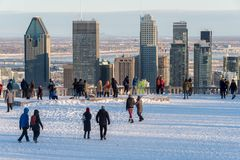 Tourists looking at Montreal Skyline in winter. Montreal, CA - 26 December 2017: Tourists looking at Montreal Skyline from Kondiaronk belvedere in winter royalty free stock photography