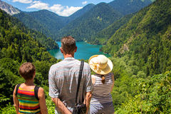 Tourists looking at mountain lake Royalty Free Stock Photos