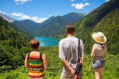 Tourists looking at mountain lake Rizza Stock Image