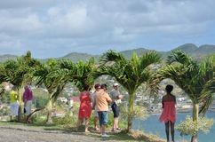 Tourists looking over small Caribbean Town Royalty Free Stock Images