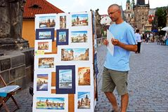Tourists looking at paintings, Prague. Royalty Free Stock Image