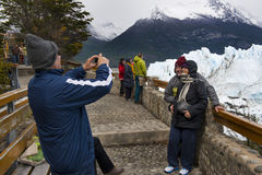 Tourists looking at the Perito Moreno Glacier in the Los Glaciares National Park, Patagonia region, Argentina. Perito Moreno Glacier, Argentina - October 26 Royalty Free Stock Photography