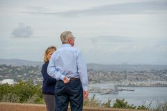 Tourists looking at the scenic view of San Diego downtown from Cabrillo National Monument stock photo