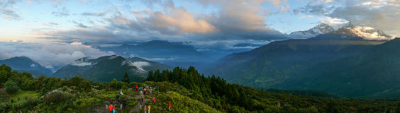 Tourists looking to Annapurna from Poon Hill, Nepal Royalty Free Stock Image