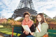 Tourists looking to map near the Eiffel Tower Stock Photo