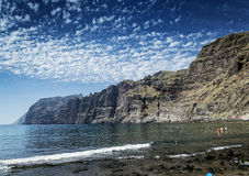 Tourists at los gigantes beach landmark south tenerife island sp Stock Photography