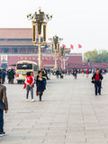 Tourists and loudspeakers on Tiananmen Square Royalty Free Stock Photography