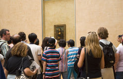 Tourists in Louvre Museum. Group of tourists gathered around the Mona Lisa in the Louvre Museum Stock Photography