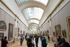 Tourists in Louvre Museum Royalty Free Stock Photography