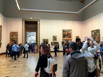 Tourists in Louvre Museum Royalty Free Stock Image