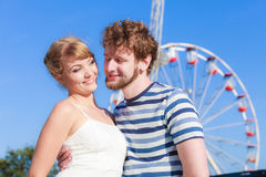 Tourists loving couple outdoor in amusement park Stock Photography