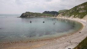 Tourists at Lulworth Cove PAN harbour Dorset England UK Stock Photography