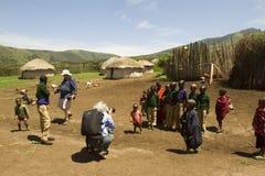 Tourists in Maasi Village, Ngorongoro Conservationa Area, Tanzan Stock Images