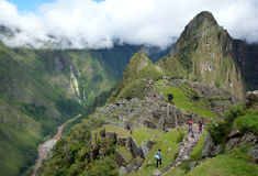 Tourists in Machu Picchu. Tourists exploring the ancient Inca city Royalty Free Stock Photography