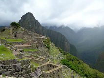 Tourists in Machu Picchu, Peru. Tourists in the ancient Inca city of Machu Picchu Royalty Free Stock Photography