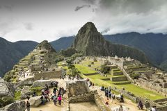 Tourists in Machu Pichu. Perú. A group of tourists access the ancient Inca city of Machu Pichu in the first morning shift royalty free stock photos