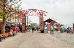 Tourists at the main entrance to Navy Pier, is a popular destination for tourists on the shoreline of Lake Michigan in Chicago. Stock Photos