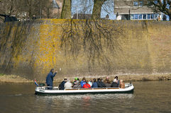 Tourists make boat trip along city wall Den Bosch. Netherlands, province North-Brabant, city 's-Hertogenbosch or Den Bosch in the conservation area, protected Royalty Free Stock Image