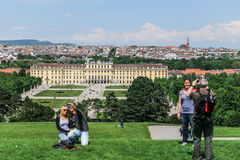 Tourists make photo on the background Schonbrunn Palace, Vienna Stock Image