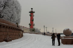 Tourists make photos of Rostral column in St. Petersburg, Russia Royalty Free Stock Image