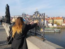 Tourists make their wishes in Prague Royalty Free Stock Photos