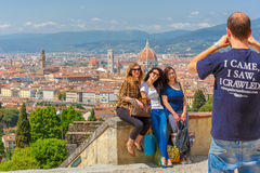 Tourists making photo in Florence, Italy Royalty Free Stock Photos