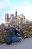 Tourists making photo near the Notre-Dame Cathedral, Paris, Royalty Free Stock Image