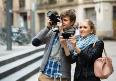 Tourists making photo at streets Stock Photos