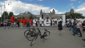 Tourists making photos at Amsterdam slogan stock video footage
