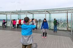 Tourists making pictures from Montparnasse tower in Paris, France Royalty Free Stock Image