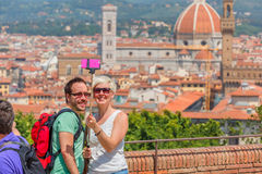 Tourists making selfie in Florence, Italy. Florence, Tuscany, Italy - May 17, 2015: Tourists young happy couple making selfie against the backdrop of the Duomo Stock Photos
