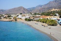 Tourists on Makrigialos beach, Crete. Stock Photo
