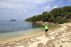 Tourists men on Aegean coast of Sithonia peninsula Stock Image