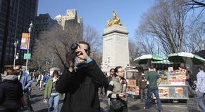 Tourists in Manhattan Royalty Free Stock Image