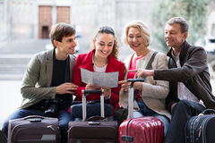 Tourists with map and baggage in city Stock Photography