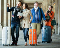 Tourists with map and baggage Royalty Free Stock Image