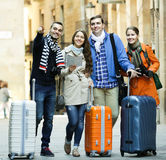 Tourists with map and baggage Stock Photo