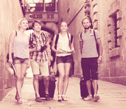 Tourists with map and camera. Group of beautiful tourists with map and camera outdoors Royalty Free Stock Photos