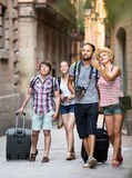 Tourists with map and camera Stock Images