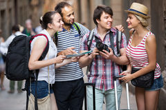 Tourists with map exploring the city destination Stock Photography