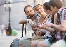 Tourists with map exploring the city destination Royalty Free Stock Images